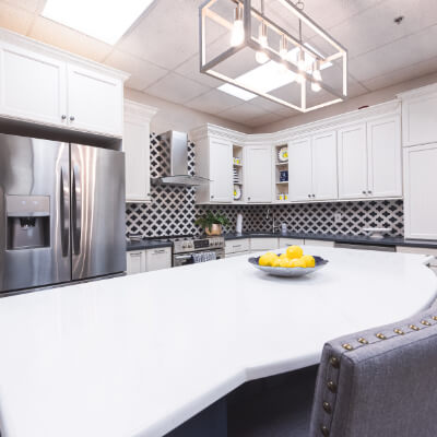 Large bright white and black showroom kitchen thumbnail