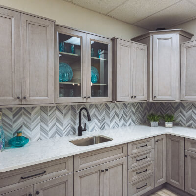 Tan and blue showroom kitchen countertops thumbnail